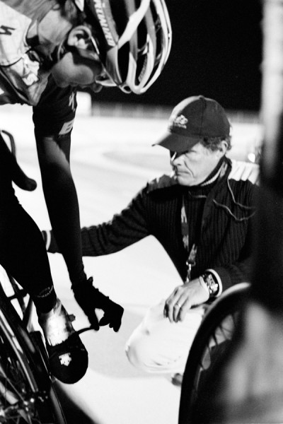 An official checks a rider's equipment at the San Diego Velodrome.